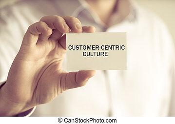 cultura, segurando, homem negócios, mensagem, customer-centric, cartão