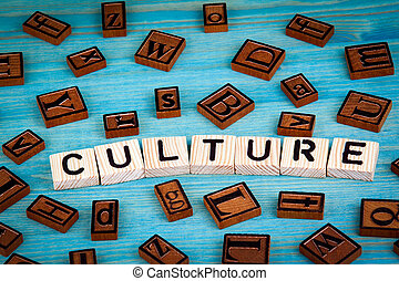 culture word written on wood block. Wooden alphabet on a blue background