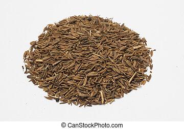 Cumin seeds on white background.