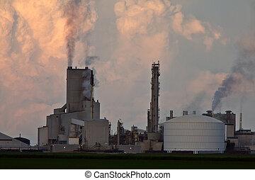 Cumulonimbus clouds behind Saskferco potash plant