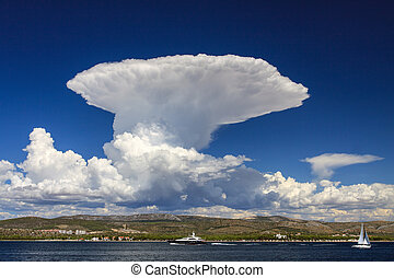Cumulonimbus - Huge cumulonimbus cloud over the sea coast. ...