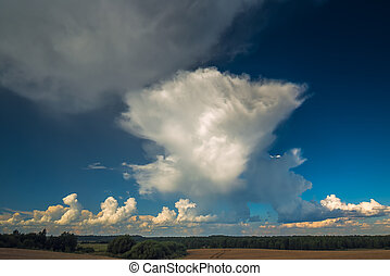 Cumulonimbus storm clouds in evening light with sun rays