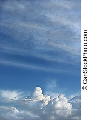 Cumulus and Cirrus Clouds - Cumulus storm clouds at low...