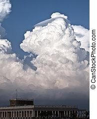 Cumulus and Lenticular - Towering detailed cumulus cloud...
