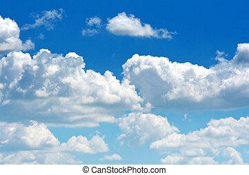 A beautiful white cumulus cloud on a blue summer sky