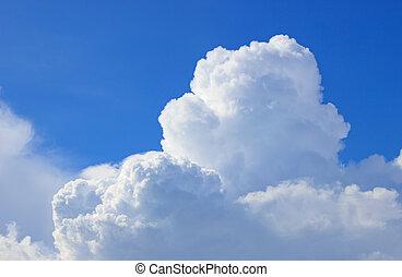 Cumulus Cloud - Dramatic, billowing Cumulus cloud, lit from...