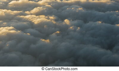 Cumulus clouds during sunset from the plane