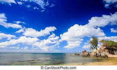 Cumulus Clouds Motion above Azure Sea Rocky Beach - cumulus...