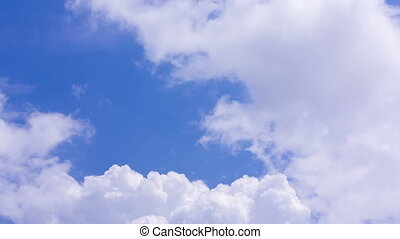 Cumulus Clouds Moving On A Blue Sky