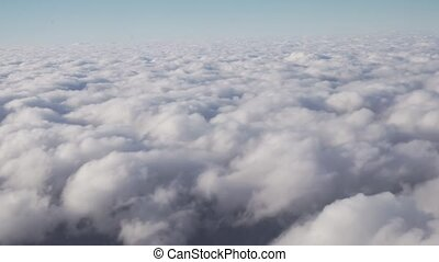 Cumulus clouds over the earth view from window stock footage video