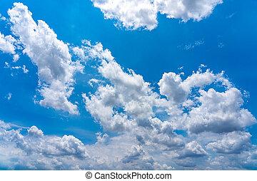 Cumulus white clouds on beautiful summer blue sky
