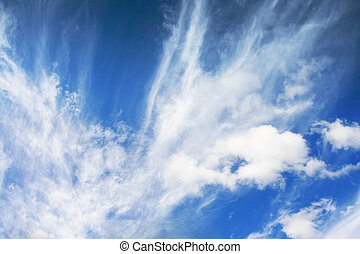 cumulus - white fluffy clouds in the blue sky