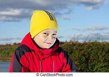 Cunning gaze - Boy in red jacket with cunning gaze outdoor ...