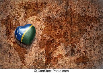 cuore, con, bandiera nazionale, di, isole solomon, su, uno, vendemmia, mappa mondo, crepa, carta, fondo., concetto