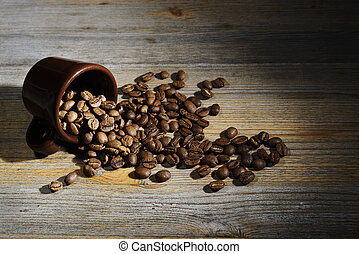 cup and coffee beans on a wooden background