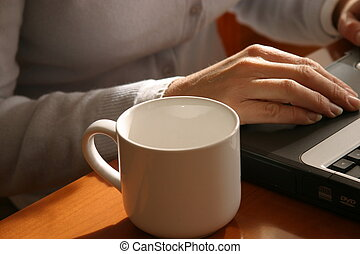 cup and computer