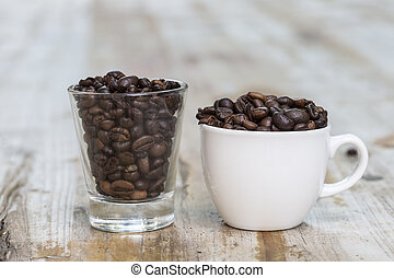 cup and glass full of coffee beans