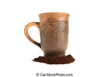 Cup and ground coffee on a white background