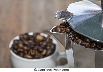 cup and mocha full of coffee beans