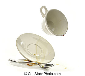 spilled coffee - Cup and saucer with spilled coffee