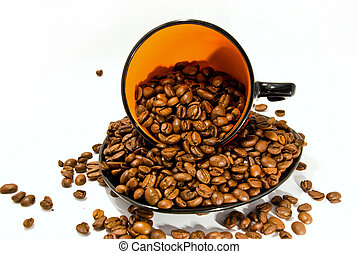 cup and saucer with the coffee beans isolated on white
