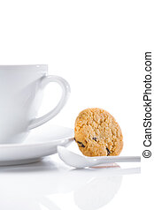 cup and spoon with cookie isolated