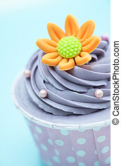 Cup cake on colorful background