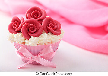 Cup cake with red marzipan roses