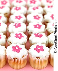 Cup Cakes - Freshly baked cup cakes with pink flowers and...