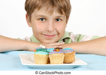 Cup Cakes on a white plate - Children\'s cup cakes sitting...
