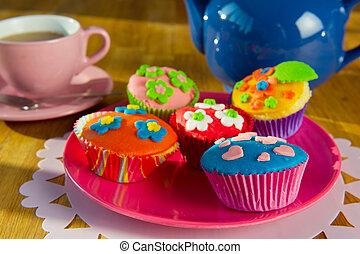 Cup cakes with tea - Colorful handmade cup cakes with cup of...