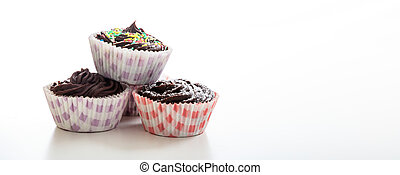 Cup chocolate cakes on a white background