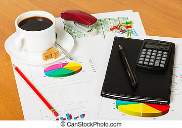 Cup coffee, calculator, notebook and other stationery to desktop background.