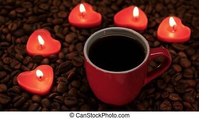 Cup coffee with lit candles in the shape of heart