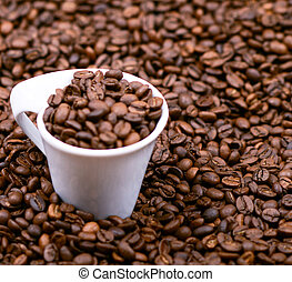 Cup filled with coffee beans