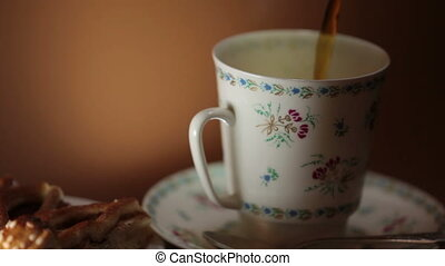 cup hot coffee close to - pour aromatic black coffee in a...