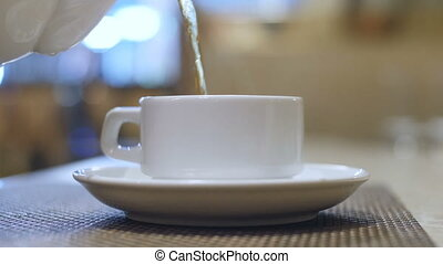 cup hot tea is poured