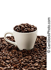Cup in coffee beans