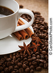 cup of aromatic coffee with cinnamon and anise star. still ...