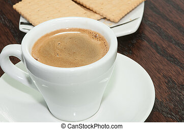 Cup of aromatic espresso coffee and biscuits