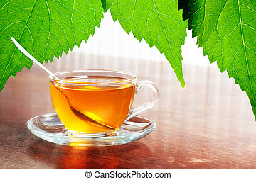 cup of aromatic tea on wooden table