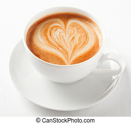 Cup of art cappuccino with a decorative heart