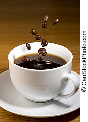 Cup of black cofee with coffee beans - Cup of black coffee ...