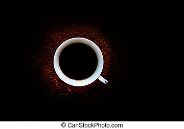 Cup of black coffee on a dark background