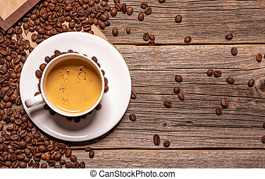 Cup of black coffee on a wooden background.