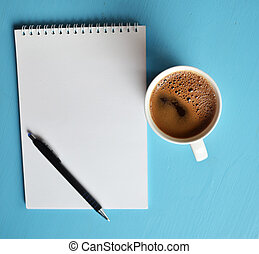 Cup of black coffee on blue background