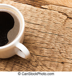 Cup of black coffee on old wooden table
