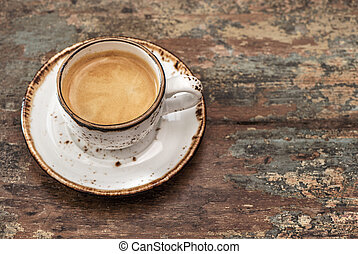 Cup of black coffee on wooden background