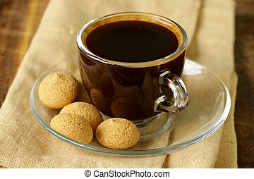 cup of black coffee with biscuits