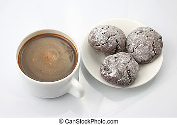 cup of black coffee with biscuits on white background